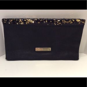 BCBGeneration black and gold sequin clutch. EUC